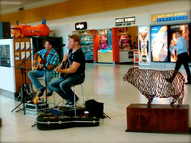 Adelaide airport has buskers on a Friday evening. This simple act totally transforms the space.
